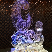 Thumb_moon_whimsical_design_with_swirl__stars_and_a_lamp_ice_sculpture